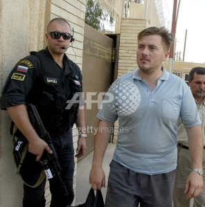 Russian security guard in Iraq with a freed hostage, or a Zaslon operator? No way of knowing...