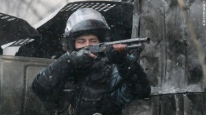 Berkut officer firing a shotgun; not the signs of a regime eager for reconciliation